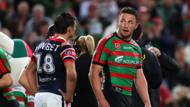 Come hair, kid: Sam Burgess and Roosters rookie Billy Smith exchange words.