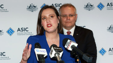 Minister for Revenue and Financial Services Kelly O'Dwyer (left) and Treasurer Scott Morrison, long opponents of a banking royal commission, hold a press conference at ASIC offices in Melbourne this week.