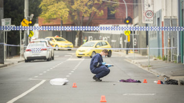 Forensic officers examine the scene of a shooting outside Love Machine nightclub in Prahran.