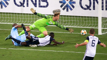 Edgar Da Silva scores past goalkeeper Lawrence Thomas.