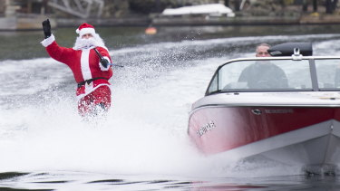 A water skier dressed as Santa Claus skis in Deep Cove, North Vancouver, British Columbia, on Christmas Eve.