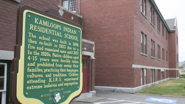 A plaque is seen outside of the former Kamloops Indian Residential School on Tk'emlups te Secwépemc First Nation in Kamloops, British Columbia, Canada.