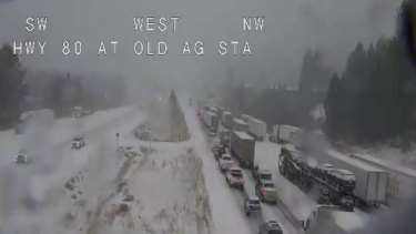 Remote video traffic camera footage shows traffic is stopped along California's Interstate 80 because of multiple spinouts.