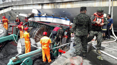 Rescuers work at the site of a collapsed bridge in Nanfangao, eastern Taiwan.