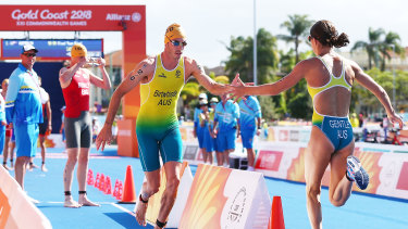 Australians Jake Birtwhistle and Ashleigh Gentle change over during the triathlon mixed team relay at the Gold Coast Commonwealth Games in 2018. The pair will both represent Australia in Tokyo.