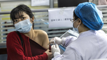 Residents receive the COVID-19 vaccine at a community hospital in Wuhan in April.