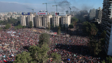 Thousands of demonstrators march during a national strike in Santiago, Chile, on Tuesday.