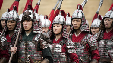 Lead actress Liu Yifei (centre) handles the martial arts components of the role with ease.