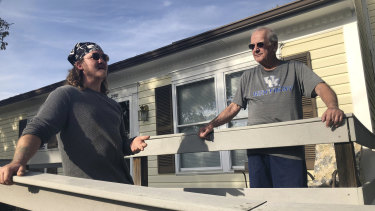 Don Albrecht, right, discusses the upcoming midterm election with his friend and handyman Joseph Robertson in Louisville, Ky. Albrecht voted for Trump in 2016 but has become frustrated with Trump's bombastic and divisive rhetoric.