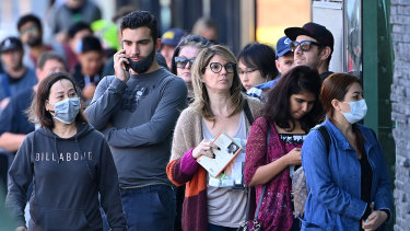 People queue outside Centrelink in Melbourne on March 24.
