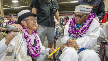 Kathleen Chavez, left, talks with her father Ray Chavez, right, then aged 104.