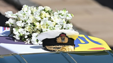 Prince Philip's Royal Navy cap rests on his coffin.