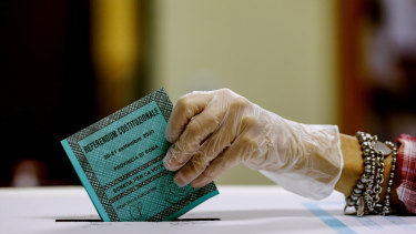A woman casts her ballot at a polling station in Rome on Monday.
