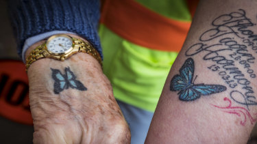Both Pams have a blue butterfly tattoo on their wrist.
