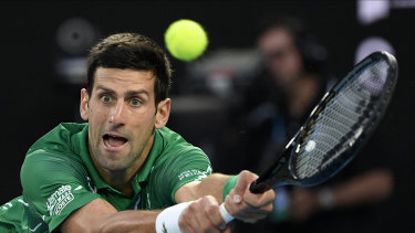 Serbia's Novak Djokovic makes a backhand return on his way to his Australian Open final victory over Austria's Dominic Thiem on February 2.
