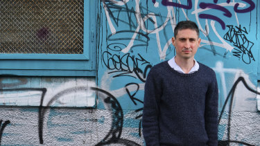 RMIT PhD researcher Liam Davies, outside a site in Clifton Hill being prepared for sale by the state government despite being identified by academics as one of the top five state sites for social housing.