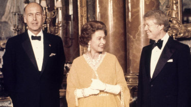 Valery Giscard d'Estaing, left, with Queen Elizabeth II and then US president Jimmy Carter at Buckingham Palace in 1977.