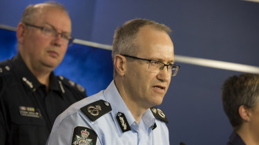 AFP Assistant Commissioner of Ian McCartney (centre) at a press conference on Saturday morning with Victoria Police chief commissioner Graeme Ashton.