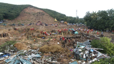 A rescue team works at a landslide-hit area in Paung township, in Myanmar, on Monday.