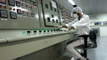An Iranian technician works at the Uranium Conversion Facility just outside Isfahan.