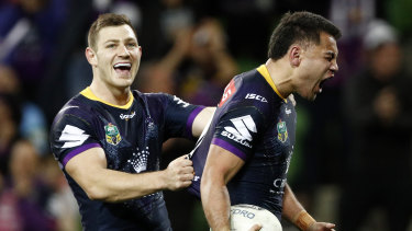 Jahrome Hughes (right) with Ryley Jacks after scoring a try for the Storm.