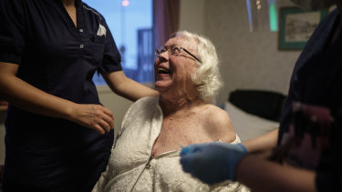 Auslag Westling, a resident at one of Attendo's nursing homes in Gothenburg receives her first dose of the Pfizer-BioNtech COVID-19 vaccine on Thursday.