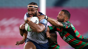 Justin Olam charges through the Rabbitohs defence.