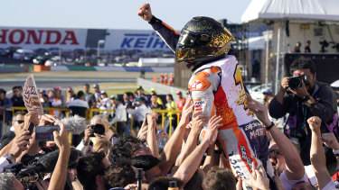 Marc Marquez celebrates with his team after victory in Japan.