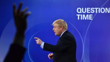 British Prime Minister Boris Johnson talks onstage during the BBC Question Time Leaders' Special on Friday.