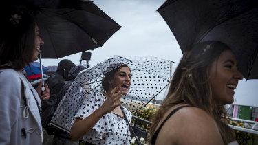 An umbrella was the accessory du jour for Jenna Peldys, Jane De Lorenzo and Kate Peldys from Ballarat.