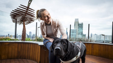 Stephanie Campbell, who experienced discrimination in her work as a real estate agent after losing her vision, with her assistance dog Rocky.