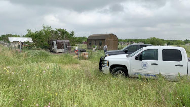 Medical examiners investigate Freddie Mack's home in Venus, Texas. Investigators later determined he was eaten by his dogs.