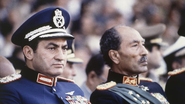 This 1981 photo was taken moments before then Egyptian president Anwar Sadat, right, and vice-president Hosni Mubarak were shot by soldiers who opened fire from a truck during a parade at review, killing Sadat and injuring Mubarak.