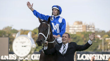 Goodbye to all that: Hugh Bowman and Chris Waller wave to fans at Randwick after Winx raced into retirement.