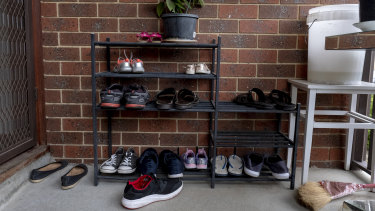 Shoes rest at the house in Dallas where a suspect was arrested.