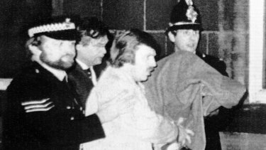 Peter Sutcliffe, under a blanket, as he was led from court in 1981.