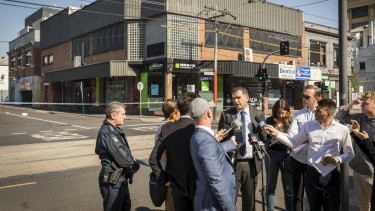 Detective Inspector Andrew Stamper addresses media at the scene of the shooting.