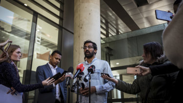 Aran Mylvaganam from the Tamil Refugee Council speaks to the media outside the Federal Court on Saturday.