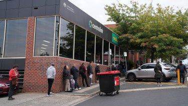 People queue outside Heidelberg Centrelink today. A two-day surge in calls to the service have congested the Telstra mobile network.