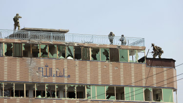 Security personnel on top of the prison where insurgents were hiding.