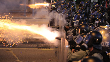 Hong Kong police fire tear gas at protesters in Sai Wan on Sunday night.