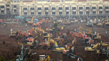 Builders race to finish the new Wuhan field hospital by the February 3 deadline.