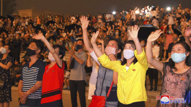 People wear face masks to help curb the spread of the coronavirus in Pyongyang, North Korea, on Monday.