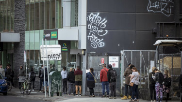 Scores of people economically affected by the coronavirus line up outside Centrelink in Richmond.