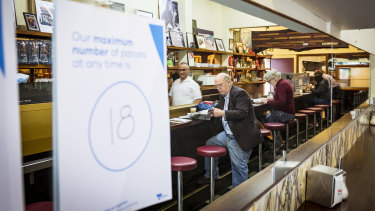 Melbourne CBD cafe Pellegrini's reopened on Monday and is operating under the enforced distancing restrictions.