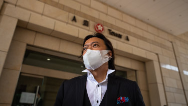 Barrister Laurence Lau, representing Tong Ying-kit (not pictured) who is accused of deliberately driving his motorcycle into a group of police officers, speaks to the media outside court in Kowloon, Hong Kong.