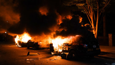 Cars burn during a protest in Atlanta on Friday.