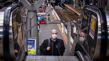 Epidemiologists are supporting a push for masks to be worn in highly populated spaces such as public transport.