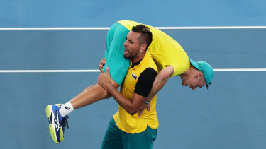 Nick Kyrgios slings Alex de Minaur over his shoulder after the win over Great Britain at the ATP Cup.