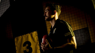 Waiting game: Ivan Soldo in the Punt Road rooms during Richmond's training session on Sunday.